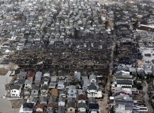 This photo shows destruction in Queens, NY, from Superstorm Sandy. (Photo courtesy: Associated Press)