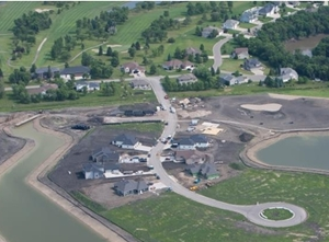 Homes in the Oxbow, ND area are in the process of being relocated and rebuilt in the protected area of a new ring levee.