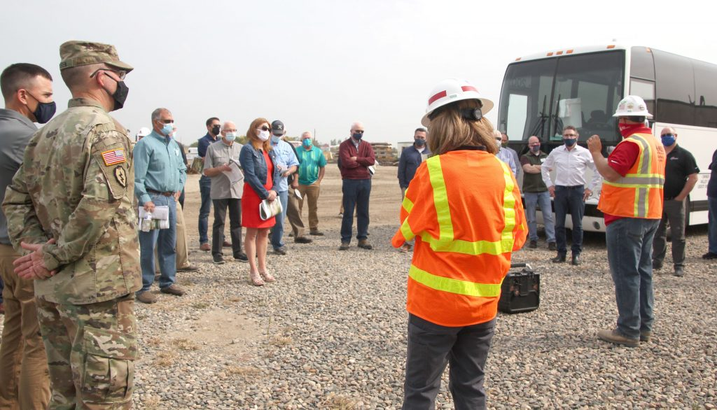 Multiple people at a construction site tour in 2020.